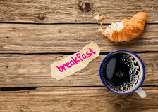 Breakfast - a half eaten croissant with espresso Stock Photography