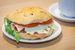 Breakfast ham, cheese and tomato bun Royalty Free Stock Images