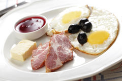 Breakfast with ham and eggs stock photos