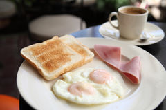 Breakfast with ham , fried egg and bread Royalty Free Stock Photo