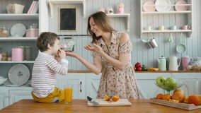 Breakfast for an happy american family, mom and little child boy at kitchen stock video footage