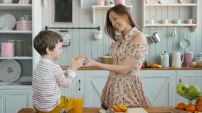 Breakfast for an happy american family, mom and little child boy at kitchen stock footage