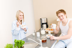Breakfast happy couple eat cereal drink coffee Stock Photo