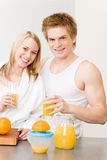 Breakfast happy couple make orange juice morning Stock Photos