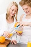 Breakfast happy couple make orange juice morning Stock Photography