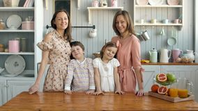 Breakfast for an happy family, sisters twins moms with two childs girl and boy morning stock video