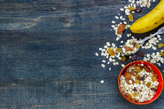 Breakfast. Healthy muesli for breakfast over dark wooden background with space for text. Health and diet concept Royalty Free Stock Images