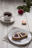 Breakfast with heart shape cookies. It is breakfast time. There are cookies and tea on the table stock photo