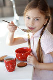 Breakfast at home. Portrait of a child having breakfast at the kitchen at home royalty free stock photos