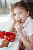 Breakfast at home. Portrait of a child having breakfast at the kitchen at home royalty free stock image