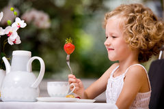 Breakfast at home. Girl at breakfast at home Royalty Free Stock Photo