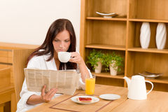 Breakfast at home happy woman read newspapers Royalty Free Stock Photo