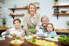 Breakfast at home. Hospitable grandparents and their grandchildren having breakfast in the kitchen Stock Photos
