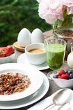 Breakfast with home made granola, green smoothie and berries royalty free stock images