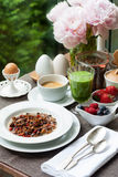 Breakfast with home made granola, green smoothie and berries royalty free stock photo
