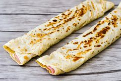 Pancakes. Breakfast  from Homemade pancakes  with  yellow cheese and ham and liac on wooden background Royalty Free Stock Image