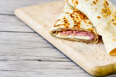 Pancakes. Breakfast  from Homemade pancakes  with  yellow cheese and ham and liac on wooden background Royalty Free Stock Photography