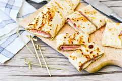Pancakes. Breakfast  from Homemade pancakes  with  yellow cheese and ham and liac on wooden background Stock Photos