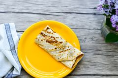 Pancakes. Breakfast  from Homemade pancakes  with  yellow cheese and ham and liac on wooden background Stock Image