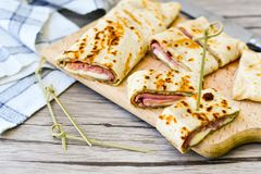 Pancakes. Breakfast  from Homemade pancakes  with  yellow cheese and ham and liac on wooden background Stock Images