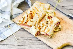 Pancakes. Breakfast  from Homemade pancakes  with  yellow cheese and ham and liac on wooden background Royalty Free Stock Photos