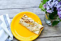 Pancakes. Breakfast  from Homemade pancakes  with  yellow cheese and ham and liac on wooden background Stock Photo