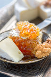 Breakfast with honey, nuts and brie cheese. Stock Image