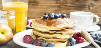 Breakfast.Honey Pancakes with Blueberries and Raspberries,Coffee Royalty Free Stock Photos