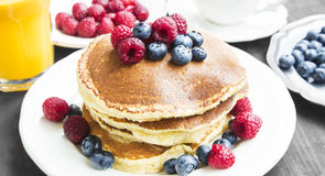 Breakfast.Honey Pancakes with Blueberries and Raspberries,Coffee Royalty Free Stock Images