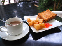 Breakfast with hot cocoa; deep-fried dough stick or Patongko with Sweetened condensed milk and toast with strawberry jam Royalty Free Stock Image