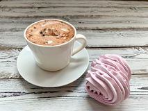 Breakfast: hot coffee and pink, raspberry marshmallow royalty free stock photo