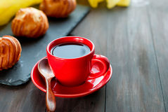 Breakfast with hot coffee and a variety of little french eclairs Royalty Free Stock Photography