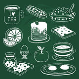 Breakfast icon set with various products drawn on chalkboard. Cute breakfast icon set with various products - tea, coffee, sandwich, porridge, orange, apple Stock Photography