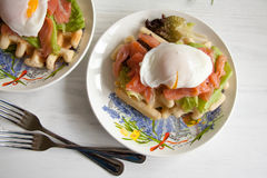 Waffles with salmon, poached egg and green salad Royalty Free Stock Photography