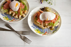 Waffles with salmon, poached egg and green salad Stock Photography