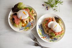 Waffles with salmon, poached egg and green salad Royalty Free Stock Images