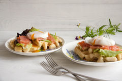 Waffles with salmon, poached egg and green salad Stock Image