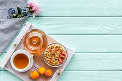 Free Breakfast In Bed With Granola, Tea And Fruit On Tray On Mint Green Wooden Background Top View Copyspace Stock Photo - 152979830