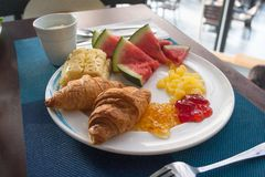 Free Breakfast In The Hotel. Croissants With Jam, Yogurt And Fruit Royalty Free Stock Image - 139248106