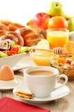 Breakfast including coffee, bread, honey, orange juice, muesli Royalty Free Stock Photos