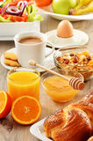 Breakfast including coffee, bread, honey, orange juice, muesli Royalty Free Stock Image