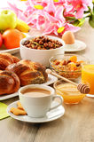 Breakfast including coffee, bread, honey, orange juice, muesli a Stock Images