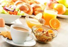 Breakfast including coffee, bread, honey, orange juice, muesli a Stock Photo