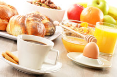 Breakfast including coffee, bread, honey, orange juice, muesli a Royalty Free Stock Images