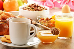 Breakfast including coffee, bread, honey, orange juice, muesli a Royalty Free Stock Photo