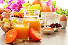Breakfast including coffee, bread, honey, orange juice, muesli Royalty Free Stock Photos