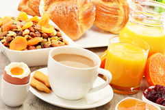 Breakfast including coffee, bread, honey, orange juice, muesli Stock Photo