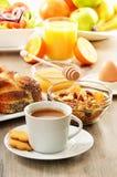 Breakfast including coffee, bread, honey, orange juice, muesli Stock Images