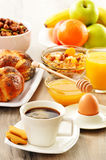 Breakfast including coffee, bread, honey, orange juice, muesli Royalty Free Stock Image