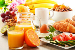Breakfast including coffee, bread, honey, orange juice, muesli Stock Image